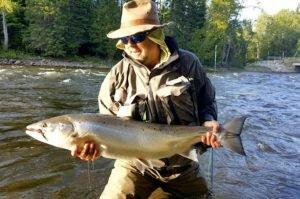 Angler showing a York River large Atlantic Salmon