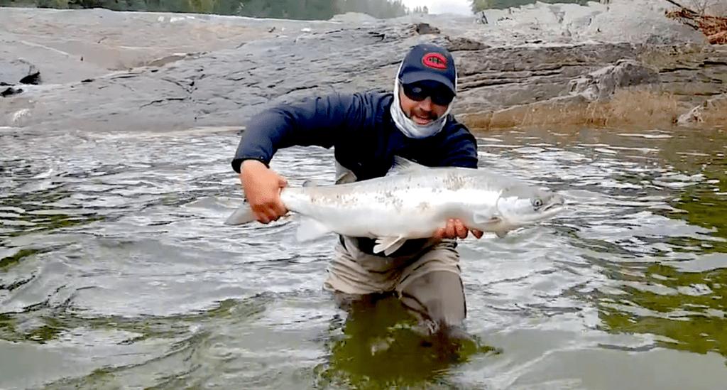 Angler shows a Dartmouth River Atlantic Salmon