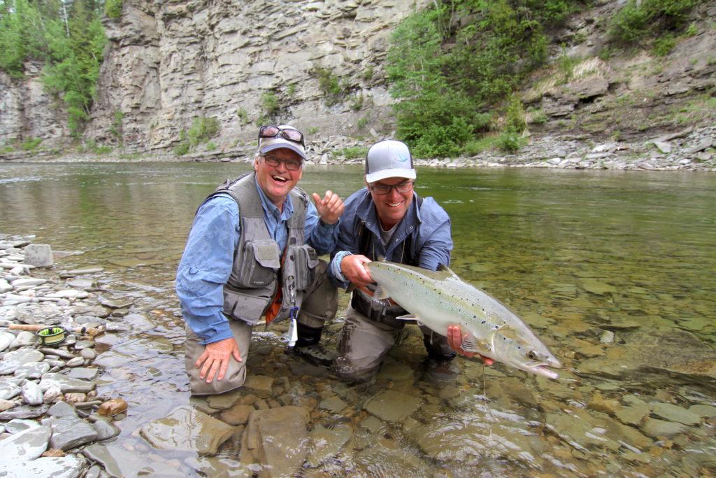 Spey anglers admiring a large, fresh York River Atlantic Salmon